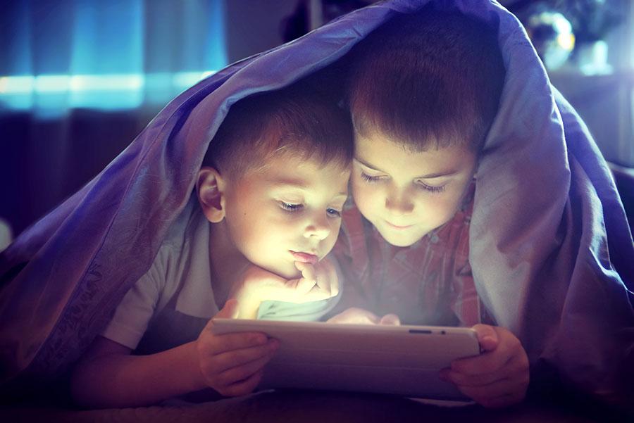 children reading a screen