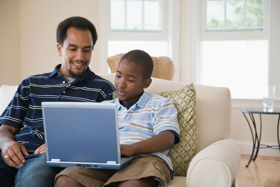 Father and son looking at a laptop together